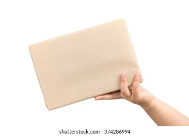 small parcel, presented on a human hand Isolated on white background