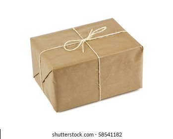 small parcel wrapped in brown packing paper, tied with twine