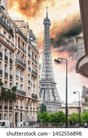 Small Paris street with view on the famous Eiffel Tower in Paris, France.