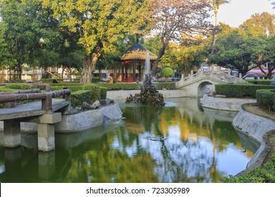 Small park with bridge, fountain at Tainan City, Taiwan