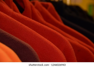 small part of colorful fleece jackets on hanger, colorful polar fleece jackets on a hanger macro shot made of recycled plastic bottles