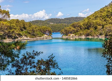 Small passage between two lakes in the National park on island Mljet, Dubrovnik archipelago, Croatia. The oldest pine forest in Europe preserved.