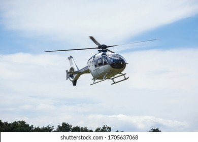 small passenger helicopter flies at an air show