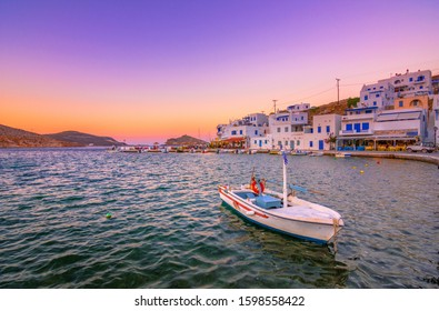 The small peaceful old harbor of picturesque Panormos at sunset, Tinos island, Greece.