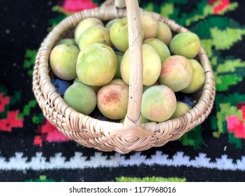 Small peaches in a basket