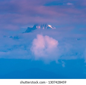 A small peak of Kanchenjunga covered with snow and clouds. Kanchenjunga is the third highest mountain in the world. It lies between Nepal and Sikkim, India,