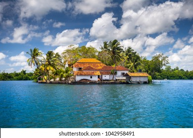 The small peninsula with the traditional buildings surrounded by the tropical plants. Idyllic place for the accommodation and relax. Balapitiya. South-western Sri Lanka.