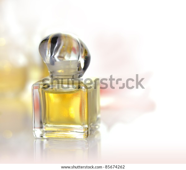 a small perfume bottle on white background