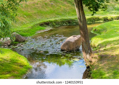 A small picturesque river with stones in the park of Grodno, Belarus