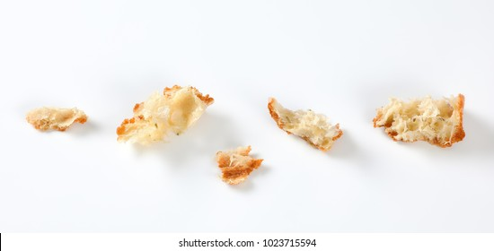 small pieces of fresh ciabatta bread on white background