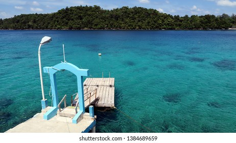 Small pier/ wooden dock on a lagoon in tropical Island of Sabang Indonesia