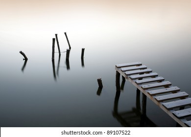 Small pier and wooden docks in the early morning