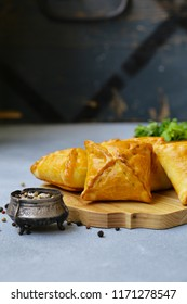 small pies with meat samsa - oriental cuisine