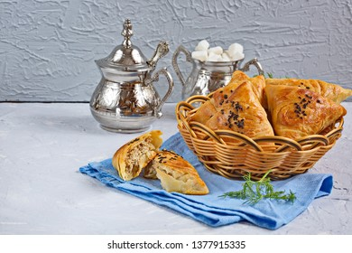 Small Pies With Meat Samsa - Oriental Cuisine. Meat dish of the peoples of Central and Central Asia, dough, meat and onions, suitable for the Nauryz or Navruz holidays,