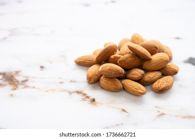 A small pile of almonds.