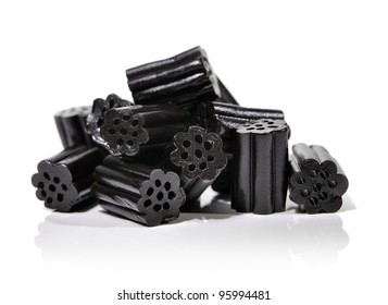 Small pile of black liquorice candies on white.