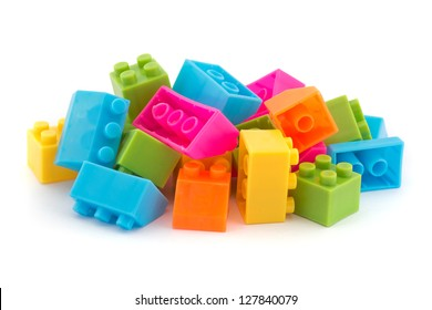 Small pile of colorful childrens building bricks on white