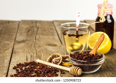 Small pile of dried sea-buckthorn berries on old wooden table. Treatment of influenza and cold. Hippophae rhamnoides.