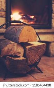 Small pile of firewood stacked next to the fire place at home