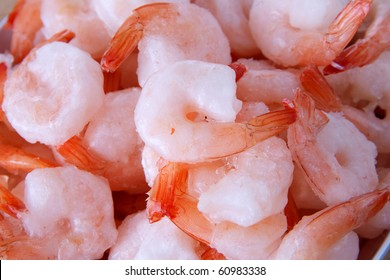 small pile of frozen shrimp closeup with tails
