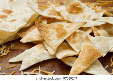 small pile of home made tortilla chips and cheese