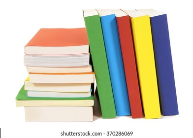 Small pile and leaning row of colorful books isolated on white
