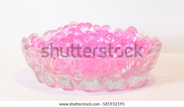 Small pink fragrant balls in a little glass holiday saucer