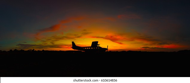 Small plane for artificial rain at sunset