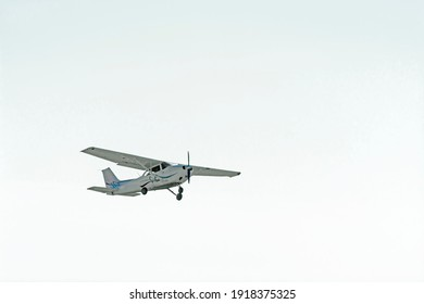 Small plane flies in the sky