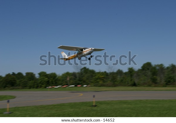 small plane on runway