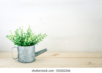 A Small Plant Pot on Wood Table Background with Copy Space for Put Your Text or Picture