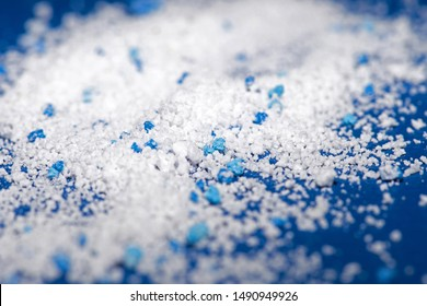 Small Plastic pellets on blue cloth.Micro plastic.air pollution