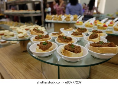 A small plate of snacks at a party in Indonesia is served as the Bruschetta.