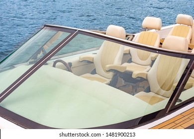 A small pleasure boat on the water. Pleasure craft with a beige leather seats. Rent boats. Travel on water. Water excursion. Summer holidays and vacations.