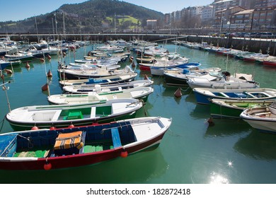 Small pleasure boats in the port of Lekeitio with blue sky, Bizkaia, Basque Country, Spain