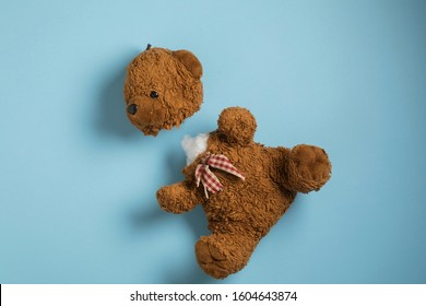 Small plush teddy bear toy with detached head, broken furry animal toy