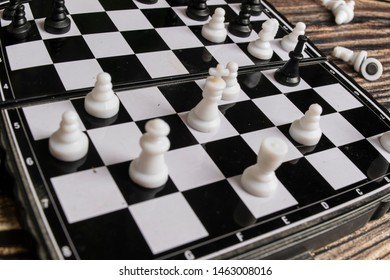 Small pocket chess on a wooden table