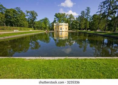 The small pond with house in summer park