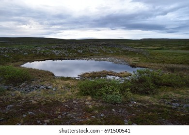 Small pond with rocky landscape in Northern Norway