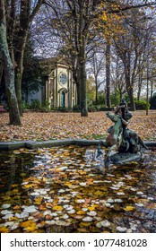 Small pool and Chapel of Carlos Alberto in Crystal Palace Gardens park, Porto, Portugal