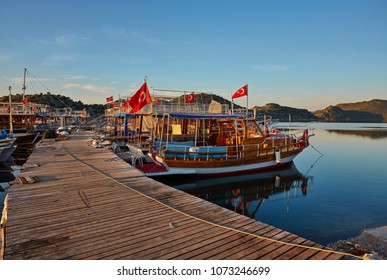 Small port of Kekova with moored yachts during sunset, Turkey