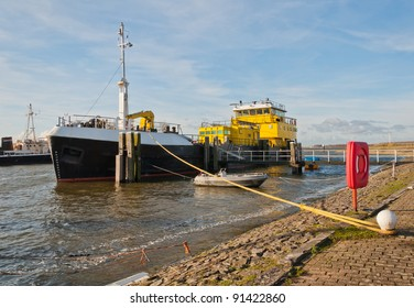 A small port near the Dutch village of Moerdijk and a moored ship