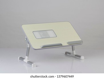 small portable table for laptop computer isolated on white background