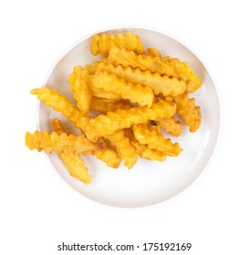 A small portion of French fries on a dish.