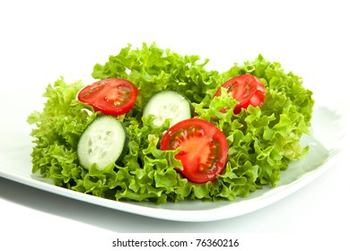 A small portion of salad on a white plate.