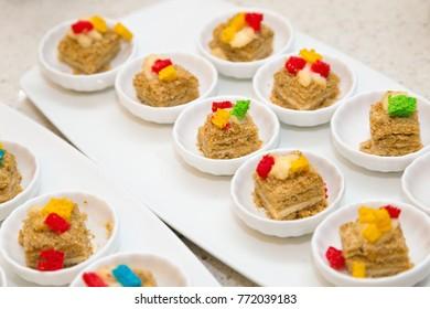 Small portioned cakes on saucers