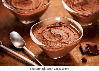 small pots of homemade dark chocolate mousse