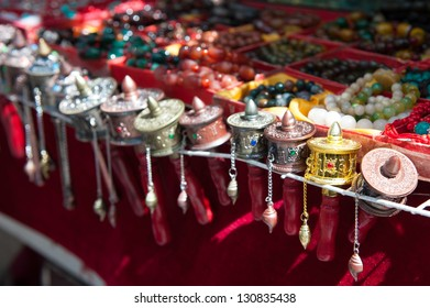 Small prayer wheels and beads