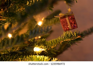 Small present hanging from Christmas tree