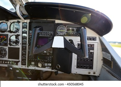 Small private motor air plane dashboard inside the cabin. Ready to take off. No models.